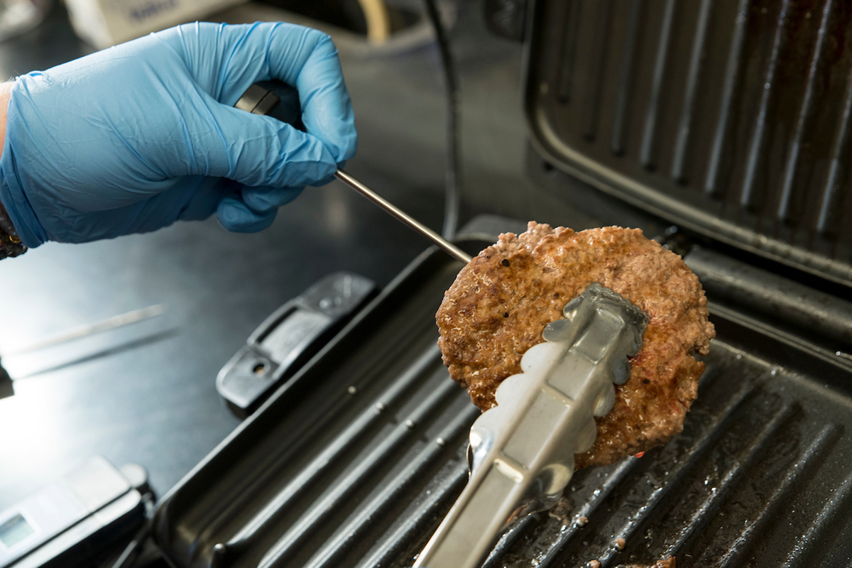 Grilling hamburger patty